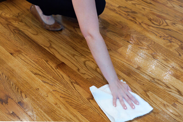 Woman drying off clean hardwood