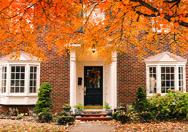 Outside of home with fall foliage