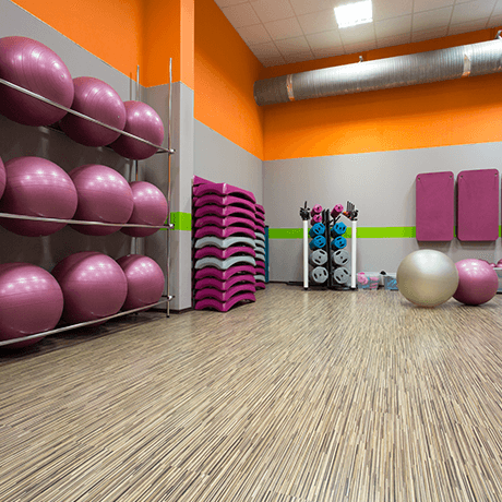 Fitness room with laminate floors and workout equipment
