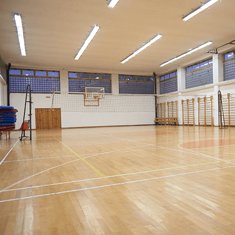 Court with hardwood floors in fitness facility