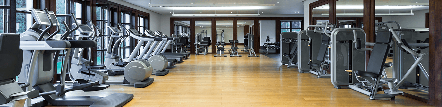 Fitness center with workout machines and hardwood floors