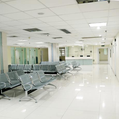 Waiting room inside hospital with white tile floors