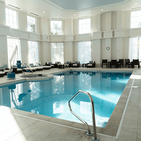 Indoor pool at hotel with tile floors