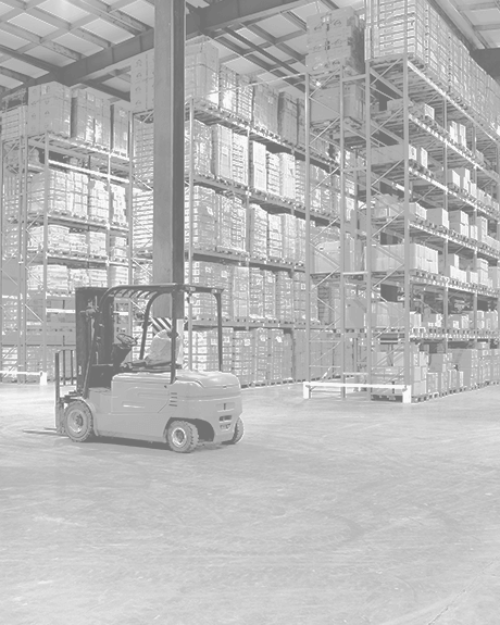 Forklift surrounded by high shelves filled with boxes in warehouse