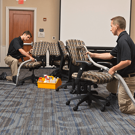 Stanley Steemer technicians cleaning upholstery on swivel chairs in office