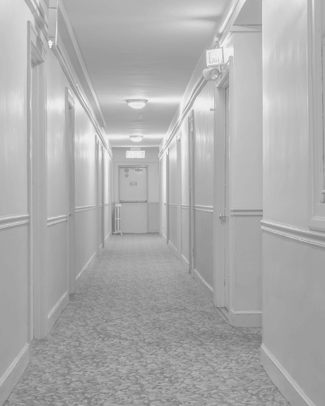Hallway of apartment complex with carpeting