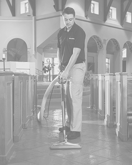Stanley Steemer technician cleaning tile and grout in church