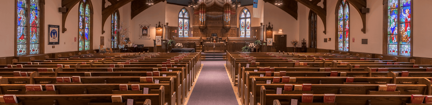 Religious facility facing the altar with rows of pews