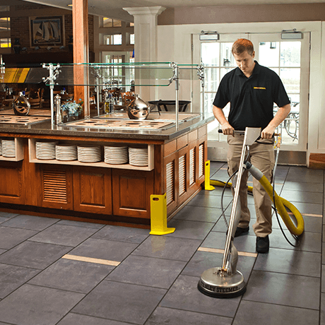 Stanley Steemer tech cleaning tile and grout near buffet at a restaurant