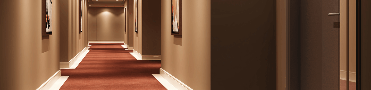 Hallway of retirement home with red carpet