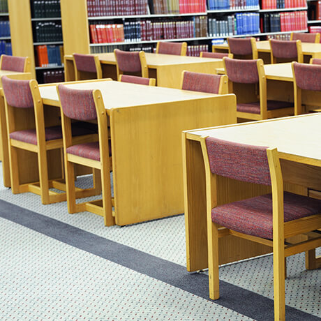 Carpet and upholstered chairs in school library