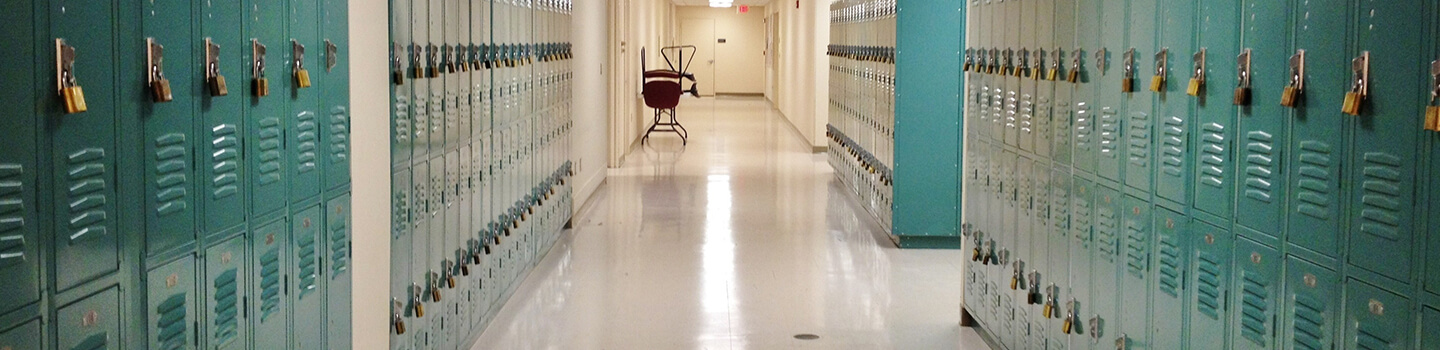 Turquoise lockers and VCT floors in school hallway