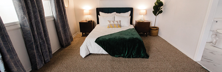Bedroom with clean carpeted floors