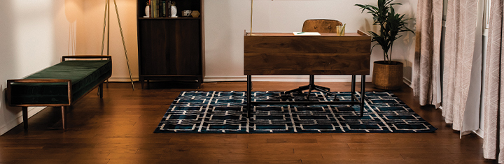 Home office with clean hardwood floors and area rug
