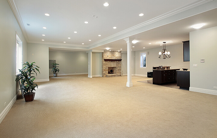Empty basement featuring carpet