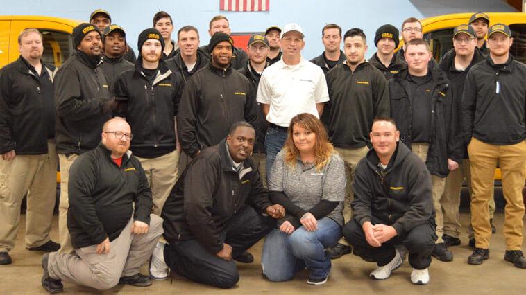 Akron, Ohio crew members in front of Stanley Steemer service vans.