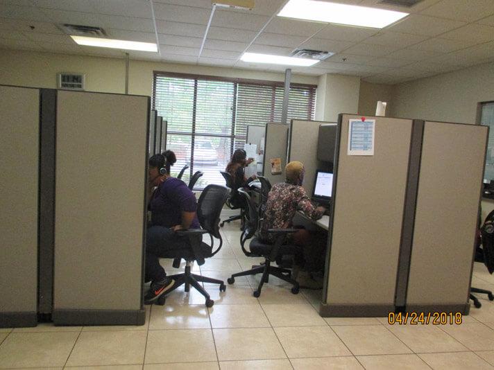 Stanley Steemer crew members sitting in the call center in Atlanta, Georgia.