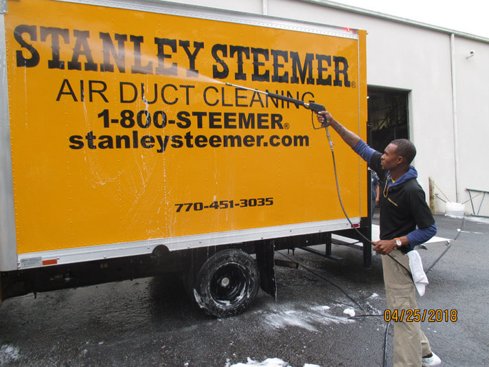 Atlanta, Georgia crew member cleaning the exterior of a air duct cleaning service van.
