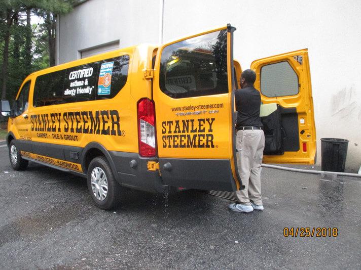 Atlanta, Georgia crew member standing outside of a carpet cleaning service van.