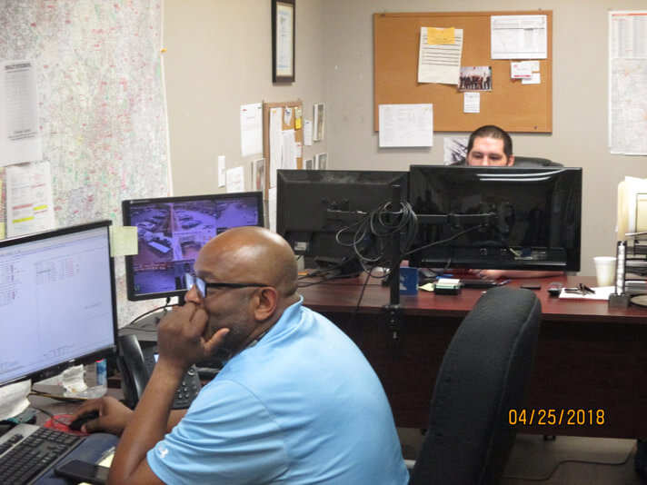 Atlanta, Georgia crew member working at his computer in the dispatch center.