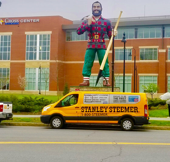 Stanley Steemer service van parked in front of the Paul Bunyan statue in Bangor, Maine