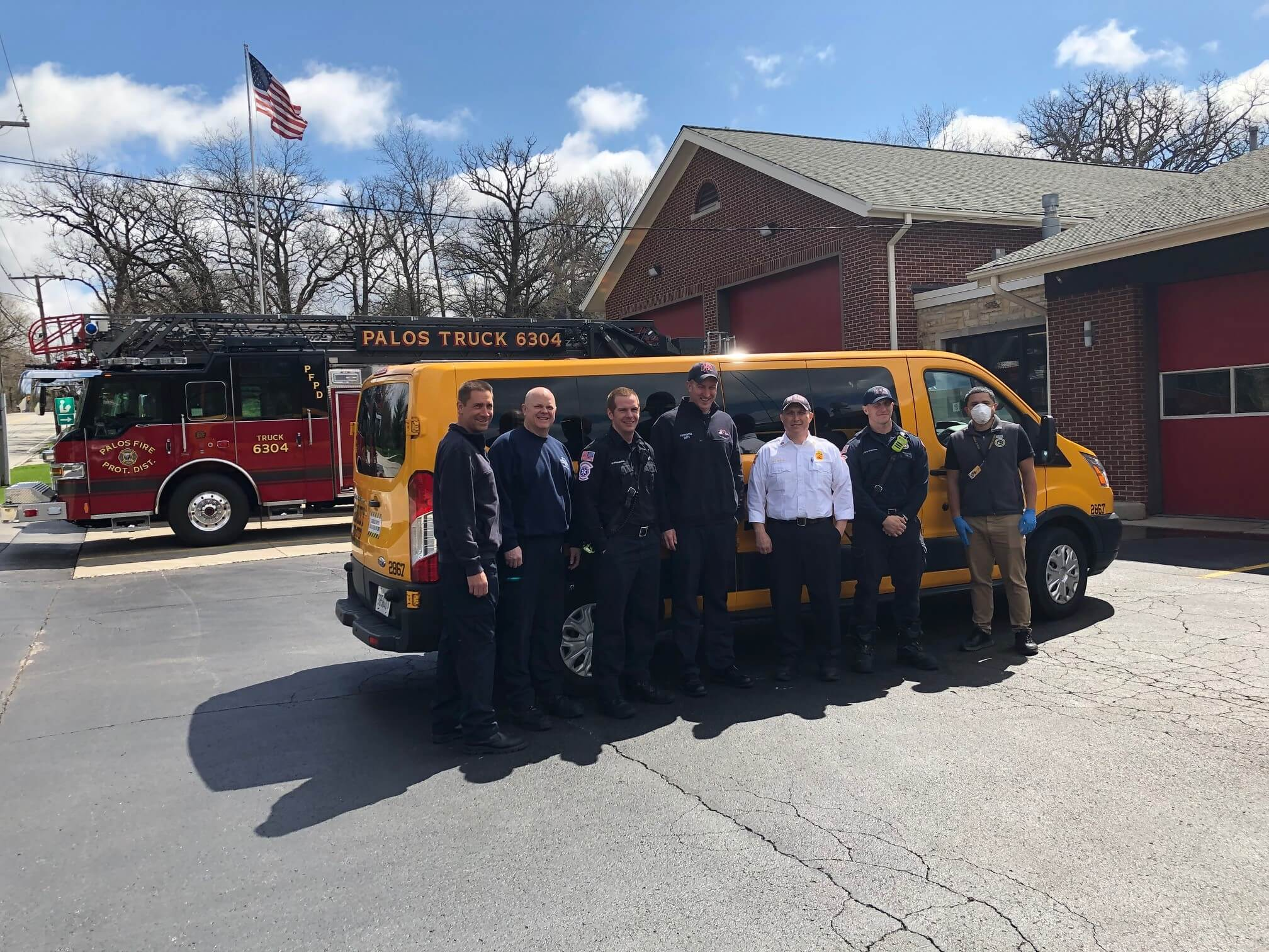 Stanley Steemer technicians pose with Bolingbrook firefighters