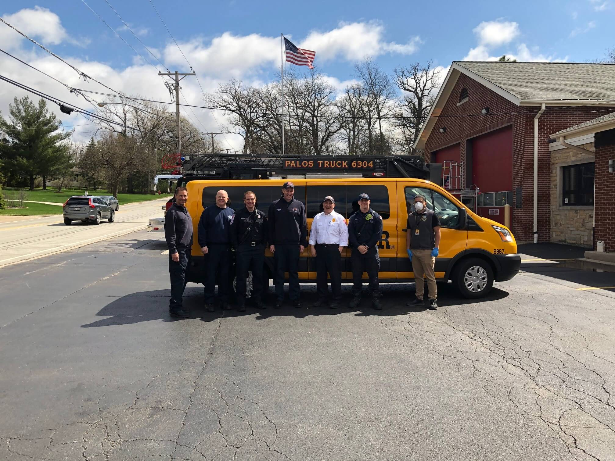 Stanley Steemer crew poses with Palos Park firefighters