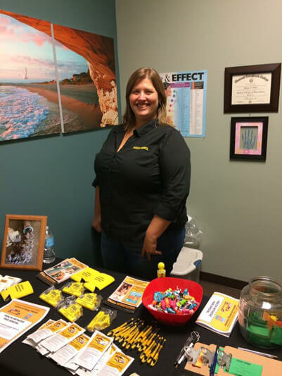 Crew member, Mrs. Dean explaining carpet cleaning services at a local health fair in Columbia, Missouri.
