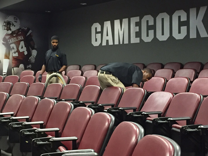 Columbia, South Carolina service technicians cleaning carpets inside of the Gamecock Football stadium.