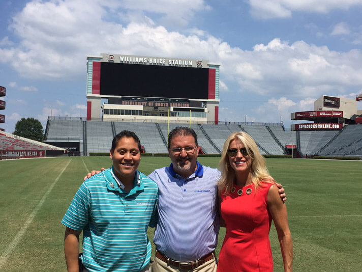 Columbia, South Carolina crew members on the field at Williams Brice Stadium.