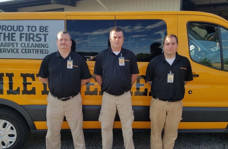 Senior technicians in Cordova, Tennessee standing in front of a carpet cleaning service van.