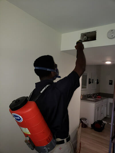 Delray Beach, FLorida air duct cleaning technician cleaning an air duct in a customer's home.