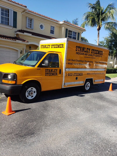 Air duct cleaning service van parked in front of a customer's home in Delray Beach, Florida.