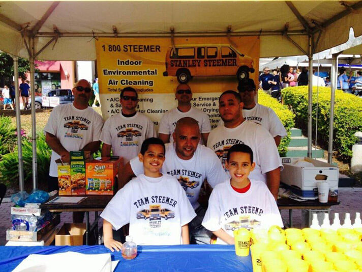 Delray Beach, Florida crew inside the Stanley Steemer tent at the Autism Speaks Walk.