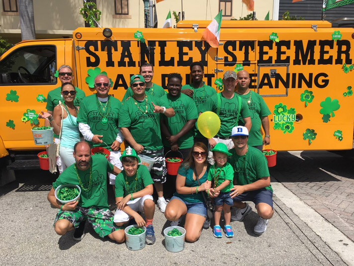 Delray Beach, Florida crew at the Saint Paddys Day Parade standing in front of an air duct cleaning service van.