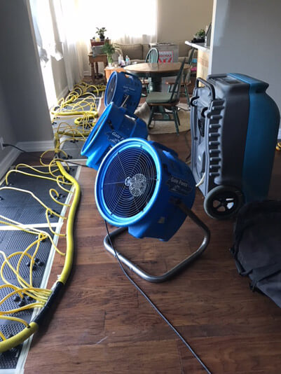 Water damage restoration equipment set up in a customer's home in Delray Beach, Florida.
