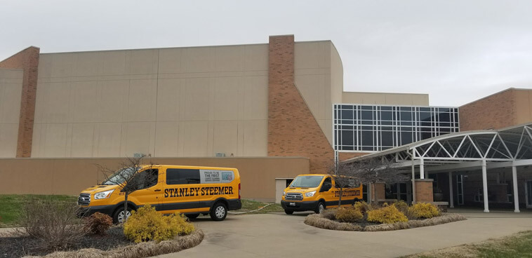 Stanley Steemer service vans parked outside of Crossroads Christian Church in Evansville, Indiana.