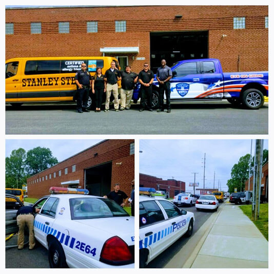 Evansville, Indiana crew at the police event, standing outside with a Stanley Steemer service van and police cars.