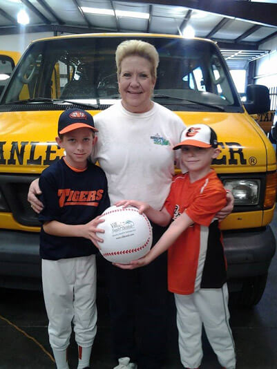 Baseball Boys and Woman in front of Stanley Steemer Van in Fayetteville North Carolina