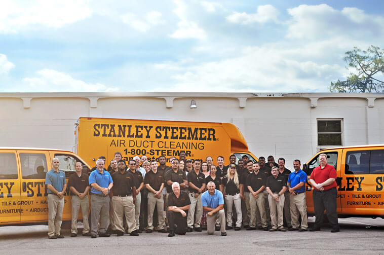 Fort Myers Florida Stanley Steemer team in front of Air Duct Cleaning Van
