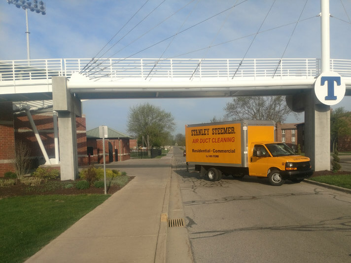 Stanley Steemer Air Duct Cleaning truck under bridge in Fort Wayne Indiana