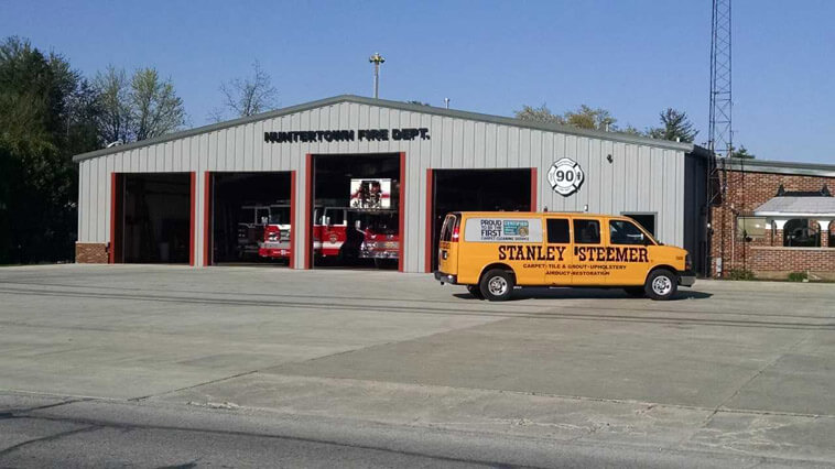 Fort Wayne Indiana Stanley Steemer Carpet Cleaning van in front of fire house