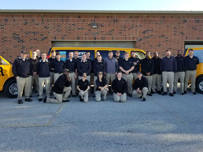 Fort Wayne Indiana Stanley Steemer Team in front of Carpet Cleaning vans