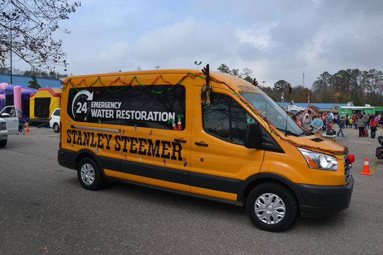 Stanley Steemer 24 Hour Emergency Water Restoration van at Christmas Parade in Hoover Alabama