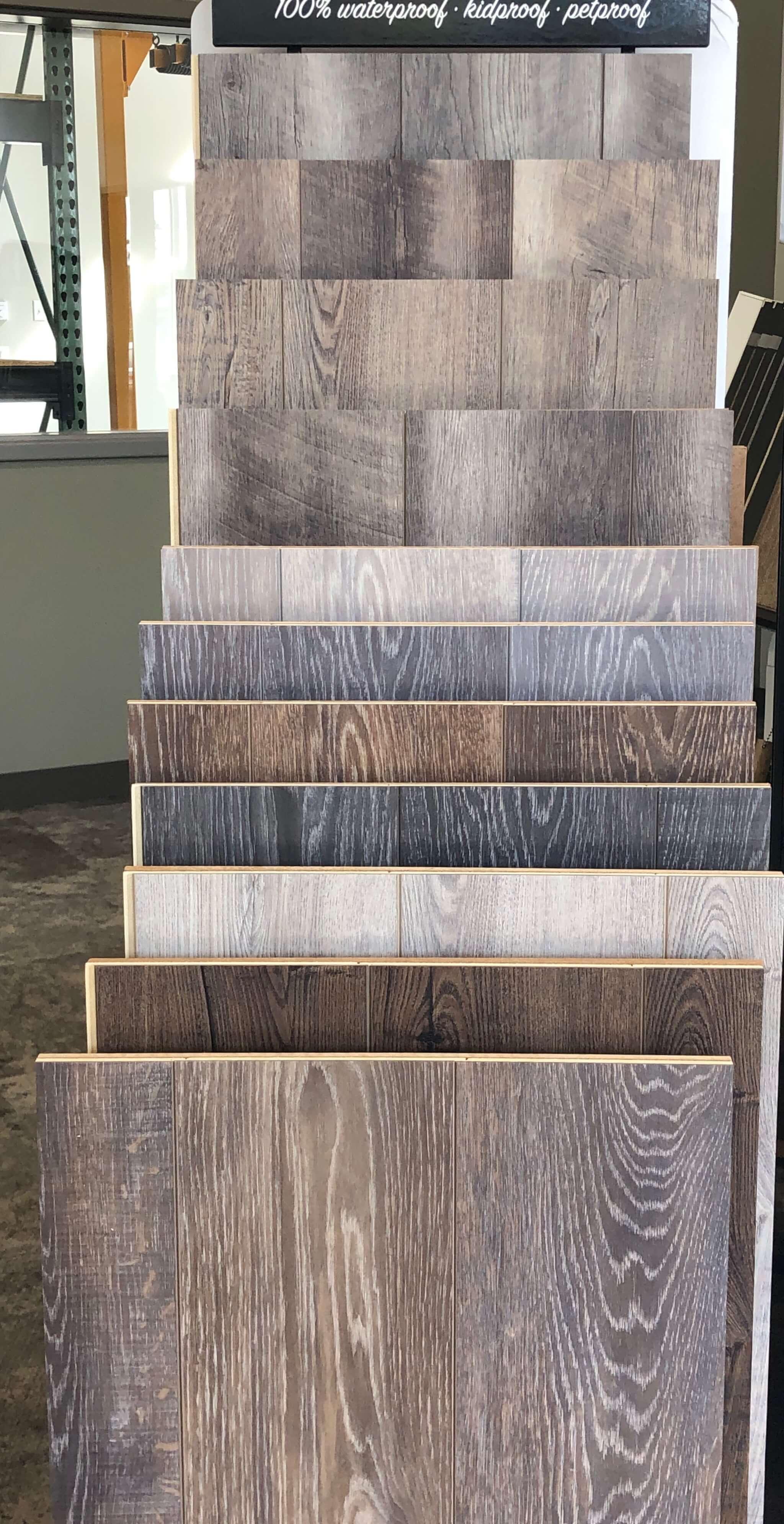 Detailed image of luxury vinyl tile samples at Stanley Steemer floor showroom in Kalamazoo