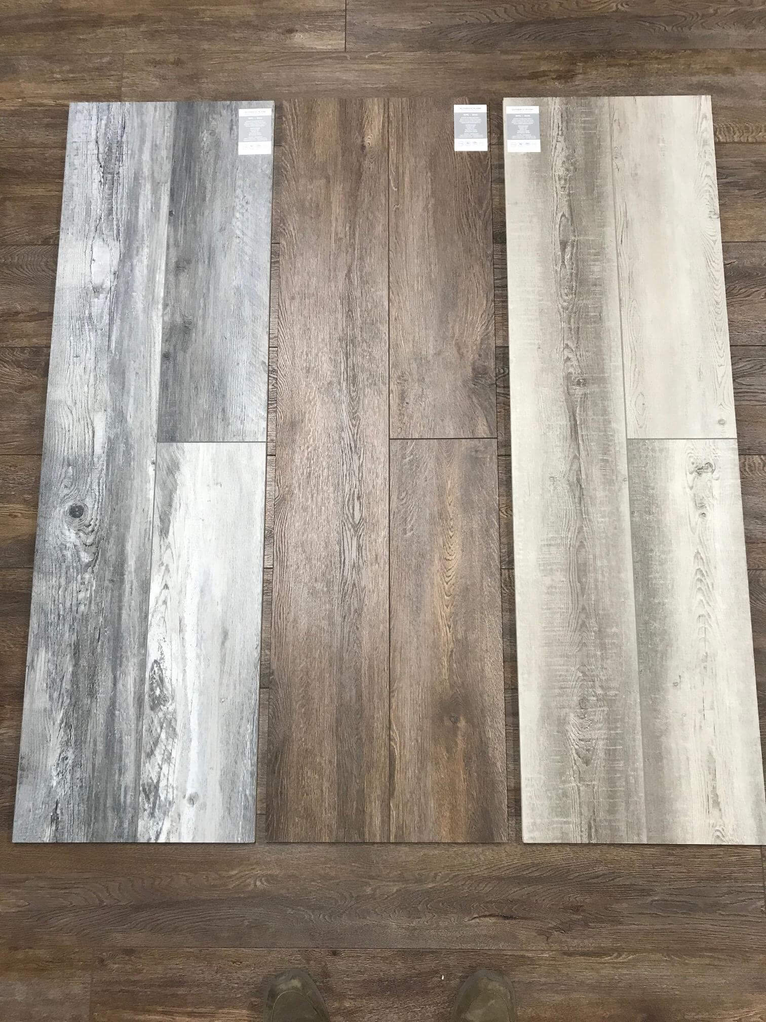 Side by side of three LVT floor samples at a Stanley Steemer showroom in Kalamazoo