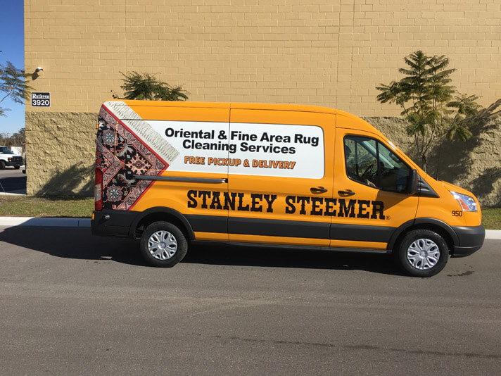 Oriental and fine area rug cleaning services van in front of building in Lakeland Florida