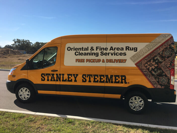 Oriental and Fine area rug cleaning services van in Lakeland Florida
