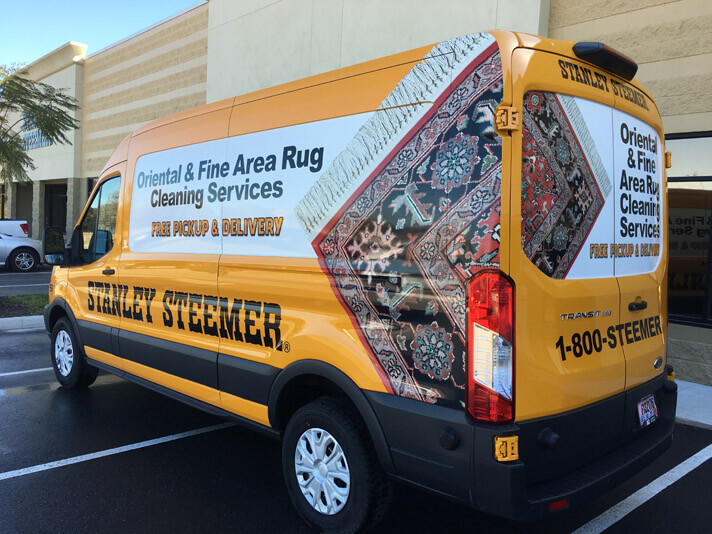 Stanley Steemer Oriental and Fine Area Rug van in parking lot in Lakeland Florida