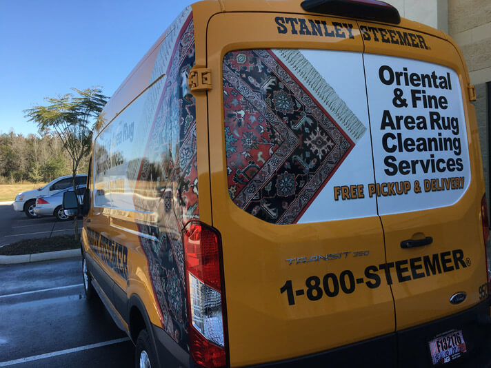 Oriential and Fine area rug cleaning services van in parking lot in Lakeland Florida
